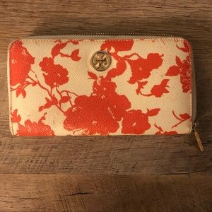 Long orange and cream Tory Burch wallet
